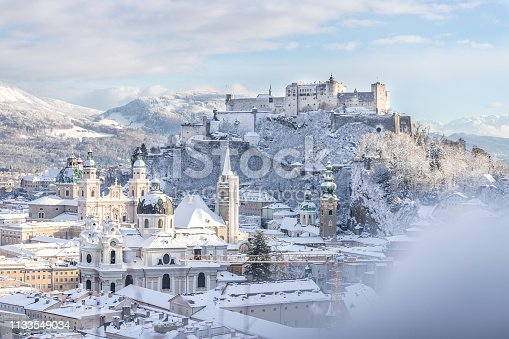 Snowy old city and fortress of Salzburg in winter, sunny day
