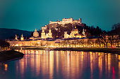 Salzburg old city, fortress, cathedral and salzach on dusk, twilight hour