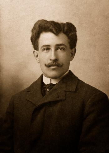 antique photograph of man in suit coat with moustache