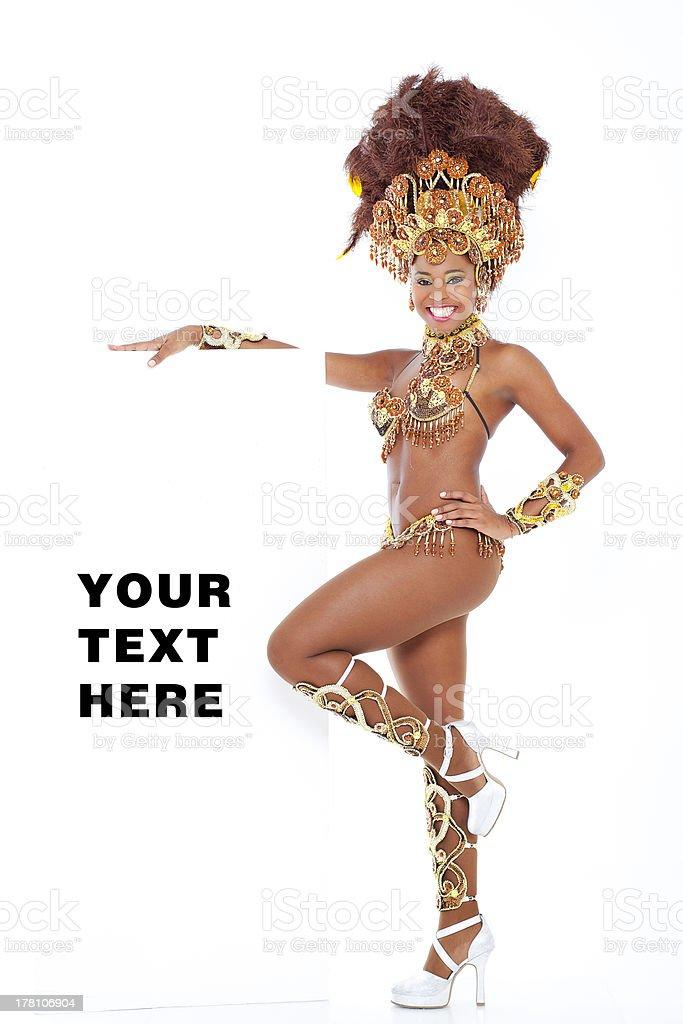 Samba dancer holding text board stock photo