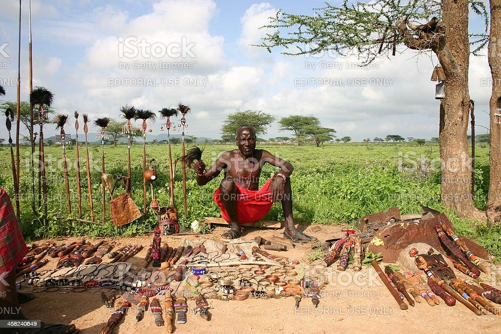 Samburu Chief is selling traditional art and craft, Kenya, Africa. stock photo