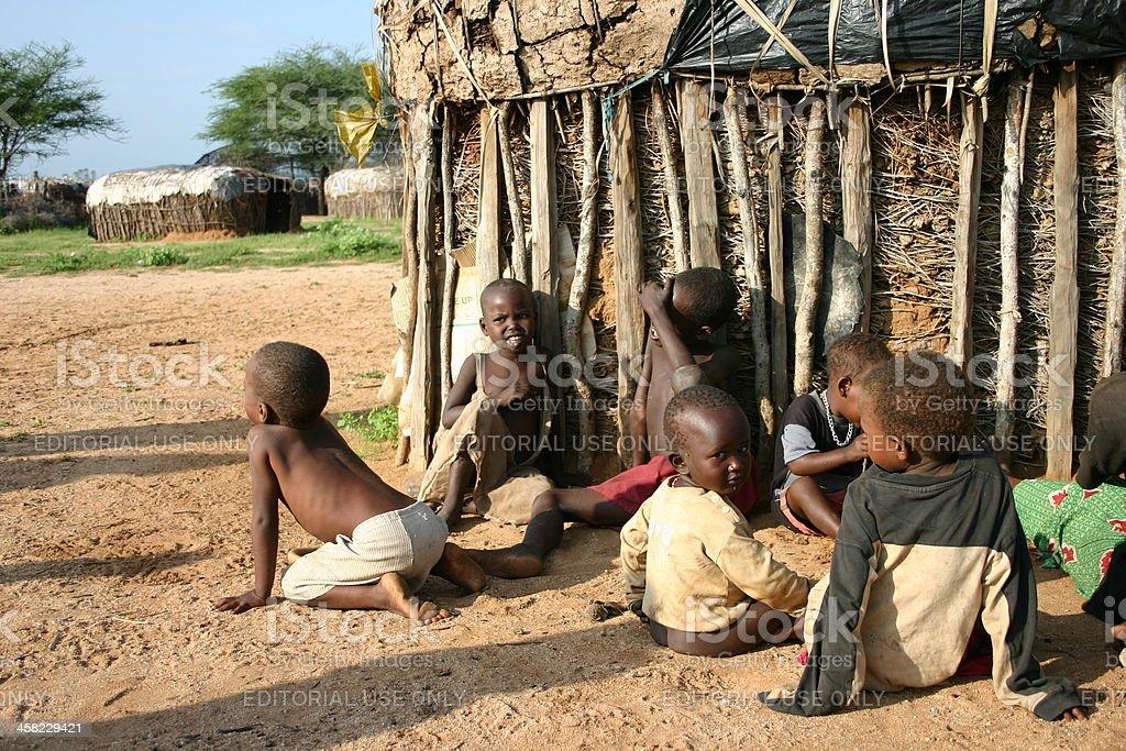 Samburu children sitting in front of their house, Africa royalty-free stock photo