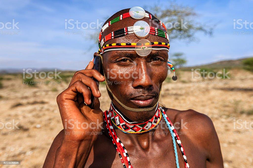 Samburu tribe warrior using mobile phone, central Kenya, East Africa – Foto