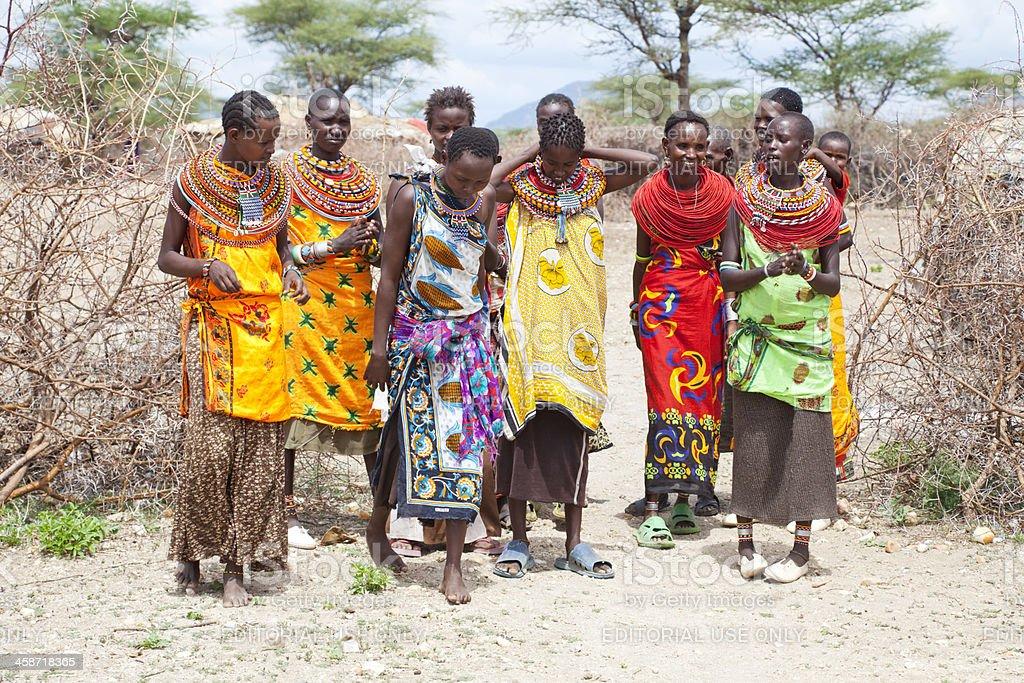 Samburu tribes women dancing under a blue African sky. royalty-free stock photo