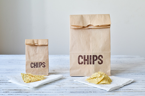 The same portion of chips given to the both the large and small bag