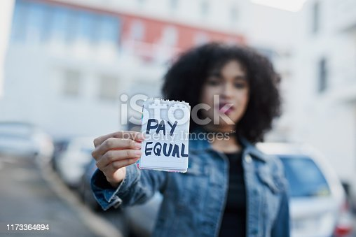 Shot of an unrecognizable woman holding a note pad written