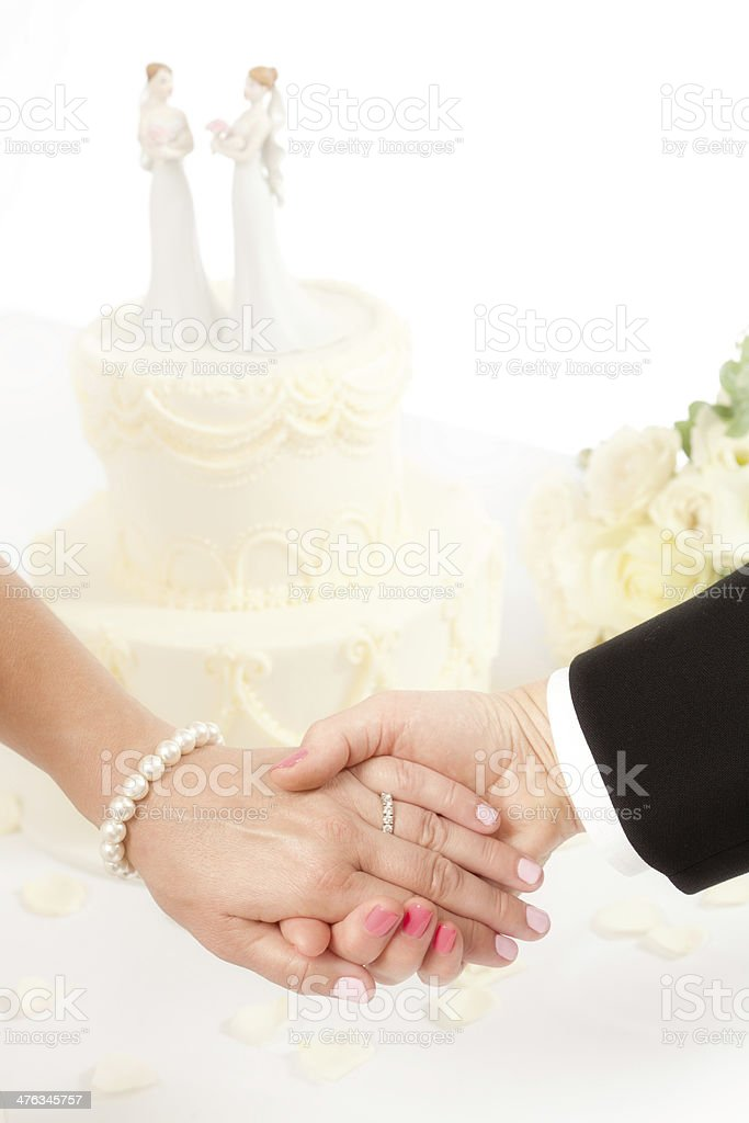 Same Sex Marriage Brides Holding Hands with Wedding Cake royalty-free stock photo