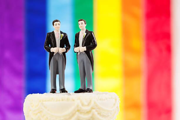 Same Sex Marriage Wedding Cake with Rainbow Flag stock photo