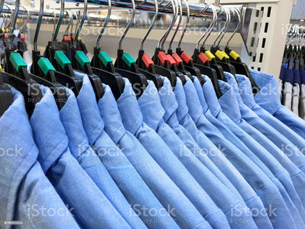 Blue Shirts Hanging Hanging on a Rack