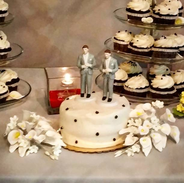Same-Sex Wedding Cake and Cupcakes stock photo