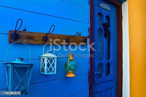 1062226450 istock photo Samos island. Greece. Samos Kokkari Village. Colorful wall and blue, white, yellow lanterns. 1181082676