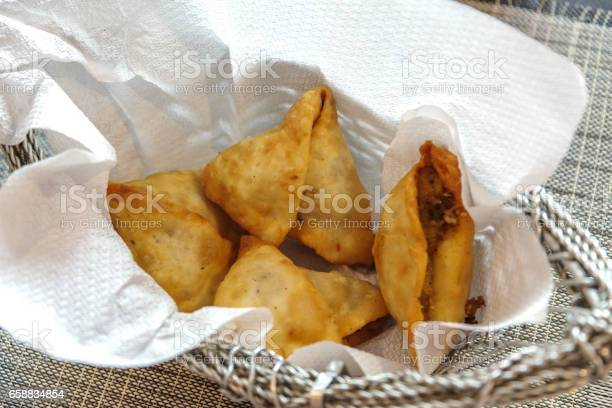 Samosa or samoosa is a fried or baked dish with a savoury filling picture id658834854?b=1&k=6&m=658834854&s=612x612&h=ejlwvwiyfknh7pnsb2hffqgx4 mf7gginuk dyy99xw=