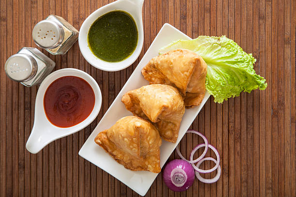 samosas, indian snack - samosa stock photos and pictures