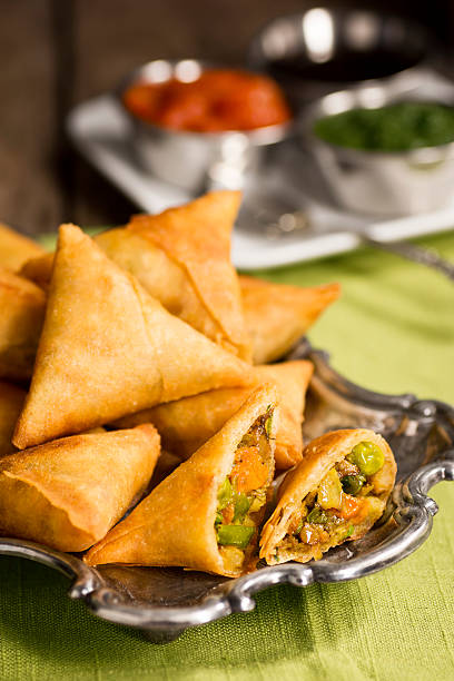 samosas with chutney and tamarind sauce - samosa stock photos and pictures