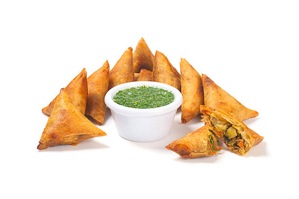 samosas with mint dipping sauce - samosa stock photos and pictures