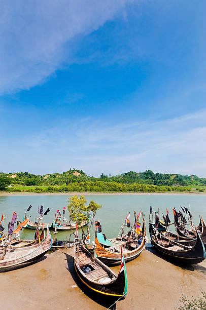 Sampan boats and the green mountain stock photo