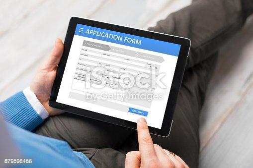 istock Sample application form on tablet computer 879598486