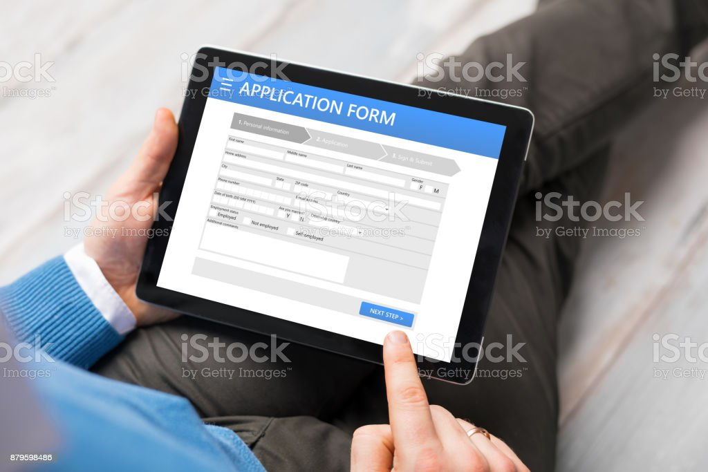 Sample application form on tablet computer stock photo