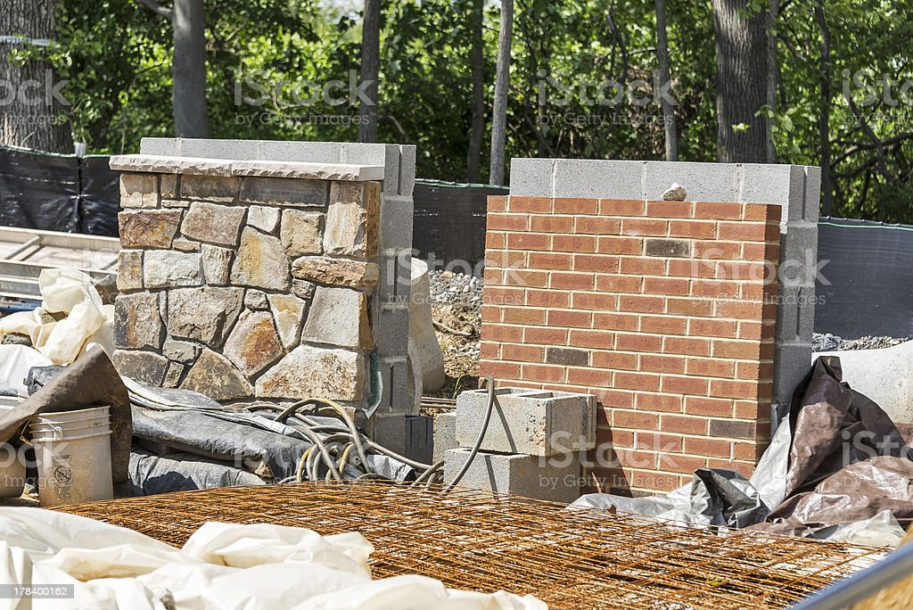 Sample brick and stone walls on construction site royalty-free stock photo