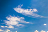 Blue sky and soft white clouds. This file is cleaned and retouched.
