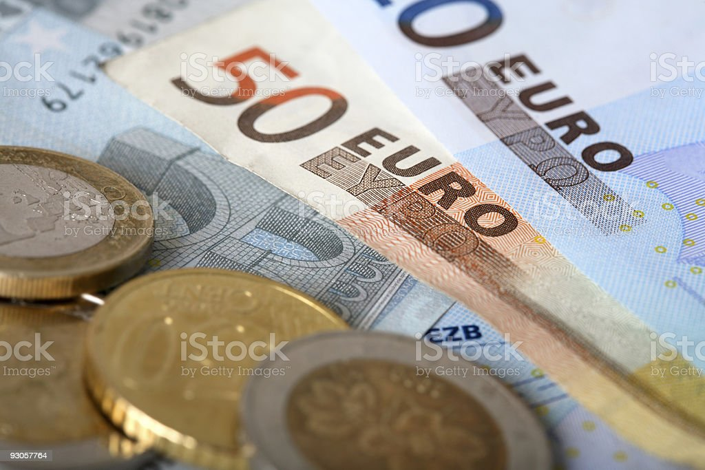 A sample of euro banknotes and coins stock photo