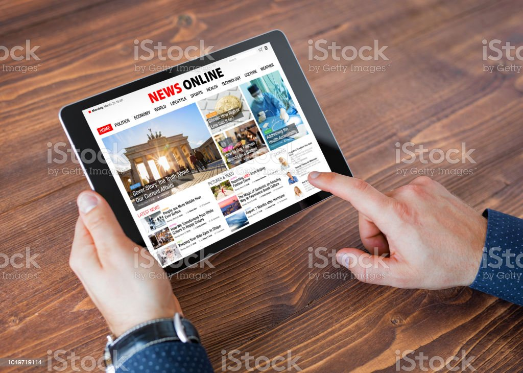 Sample online news website on tablet stock photo