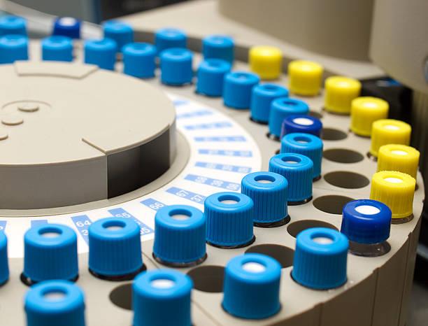 Sample Phials on a Gas Chromatograph Autosampler stock photo