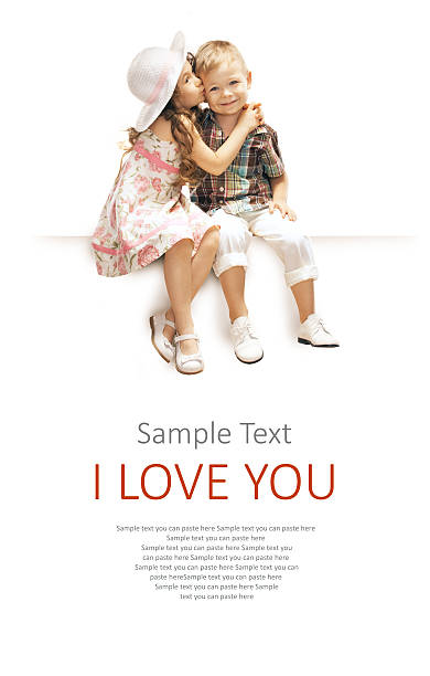 a sample text i love you with little girl kissing a boy - little girls little boys kissing love stock photos and pictures