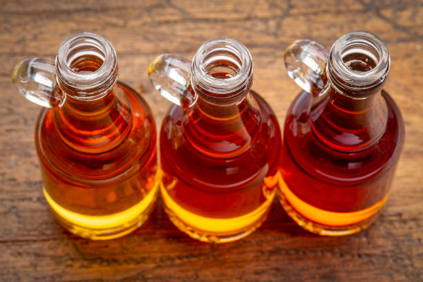 sampler of pure maple syrup - maple syrup stock photos and pictures