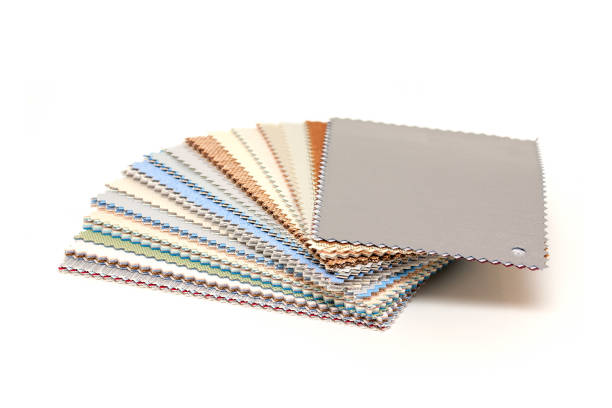 Samples of colored canvas fabric isolated on white background stock photo