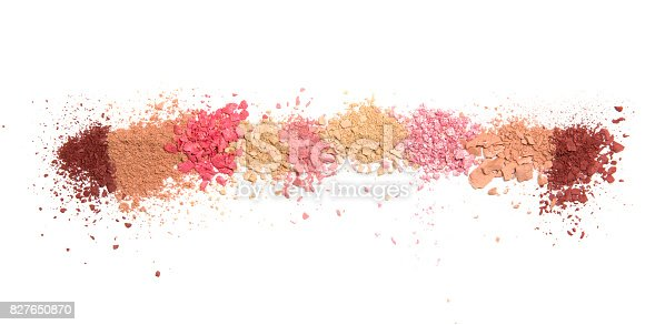 istock Samples of dry blush, powder, bronzers and highlighter scattered in a line isolated on a white background 827650870
