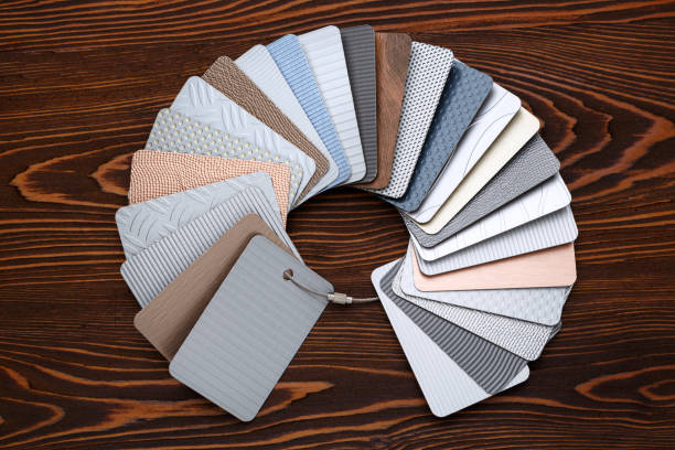 Samples of metal laminate laid out in the form of a circle on a brown Board stock photo