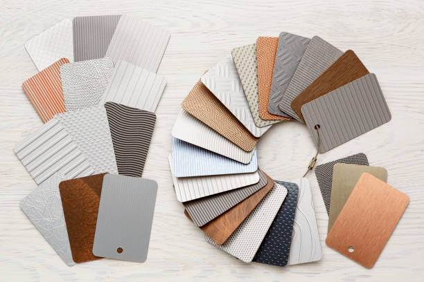 Samples of metal laminate laid out in the form of a circle, plastic with a metal coating. stock photo