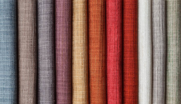 samples of multi-colored fabrics for curtains close-up. stock photo