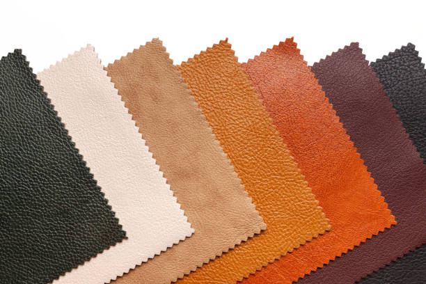 Samples of natural, textured, multi-colored leather. Top view. stock photo
