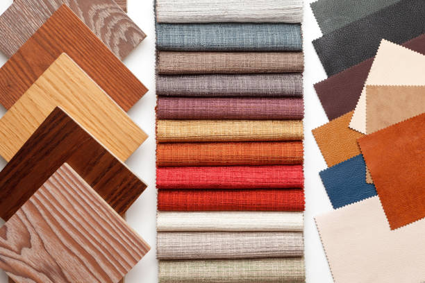 samples of parquet, fabric for curtains, and leather for the work of the interior designer. stock photo