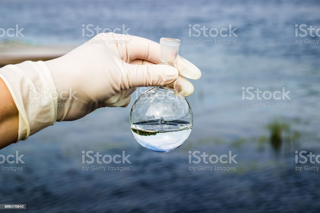 Samples of water from the river. Water intake. Water abstraction. Water diversion. stock photo