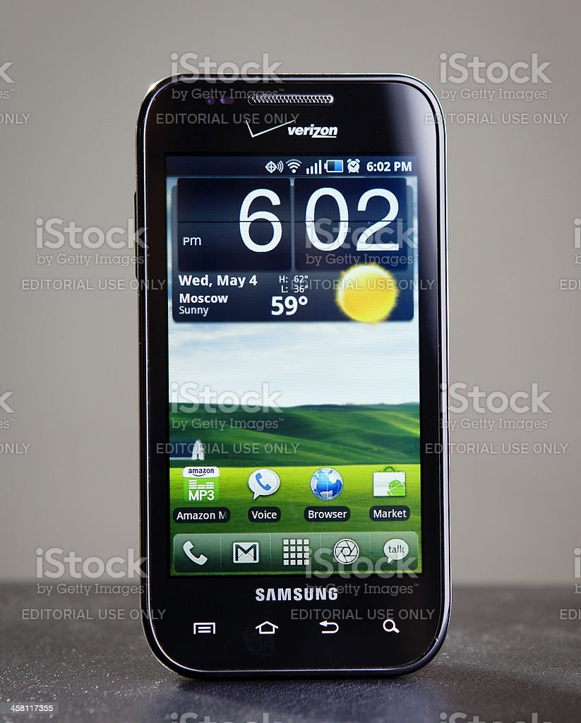 Samsung Fascinate with customized homescreen royalty-free stock photo