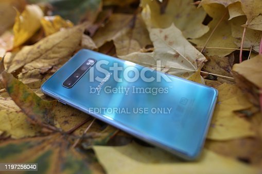 Minsk, Belarus - Oktober 16, 2019 : Samsung galaxy s 10 plus on yellow fallen foliage. Illustrative editorial