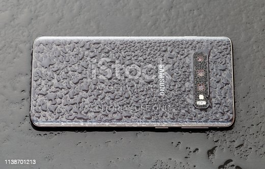 istock Samsung Galaxy S10 on a wooden surface. 1138701213