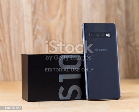 Rostov-on-Don, Russia - March 2019. Samsung Galaxy S10 on a wooden surface. A new Samsung smartphone and box close-up.