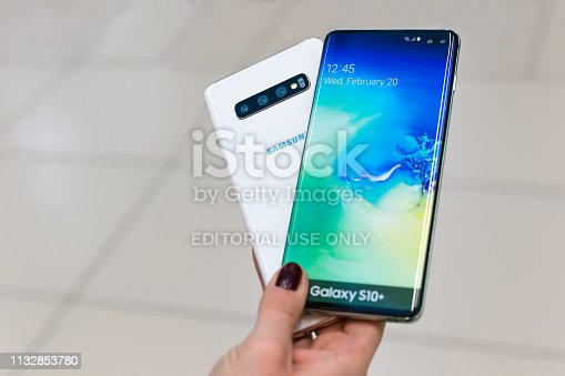 istock Samsung Galaxy S10 plus smartphone front and rear side in hand 1132853780