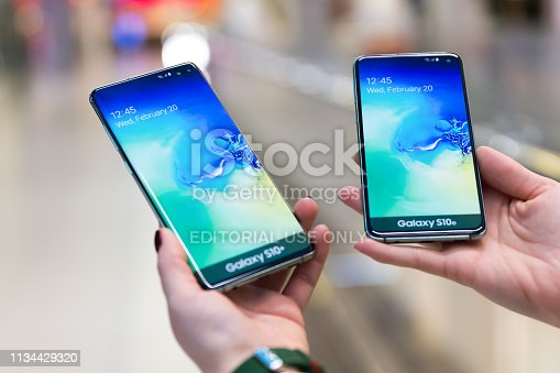 istock Samsung Galaxy S10e and S10 plus smartphones displayed in hands 1134429320