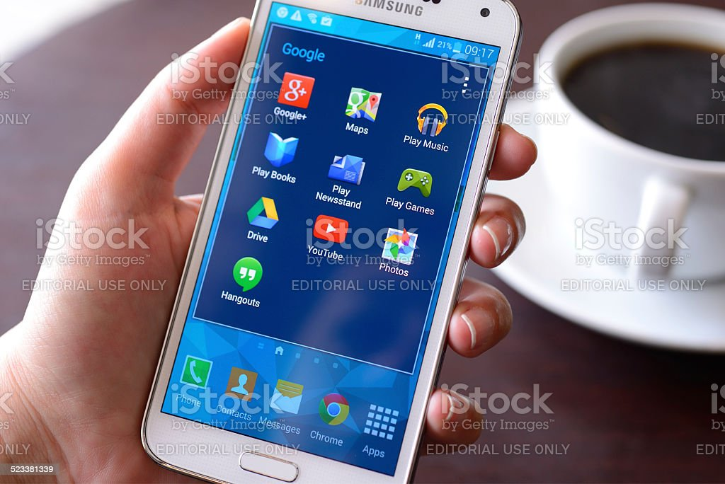 Samsung Galaxy S5 smart phone İstanbul, Turkey - April 17, 2014: Woman hand holding Samsung Galaxy S5. Samsung Galaxy S5 is a touchscreen smart phone produced by Samsung Electronics. Adult Stock Photo