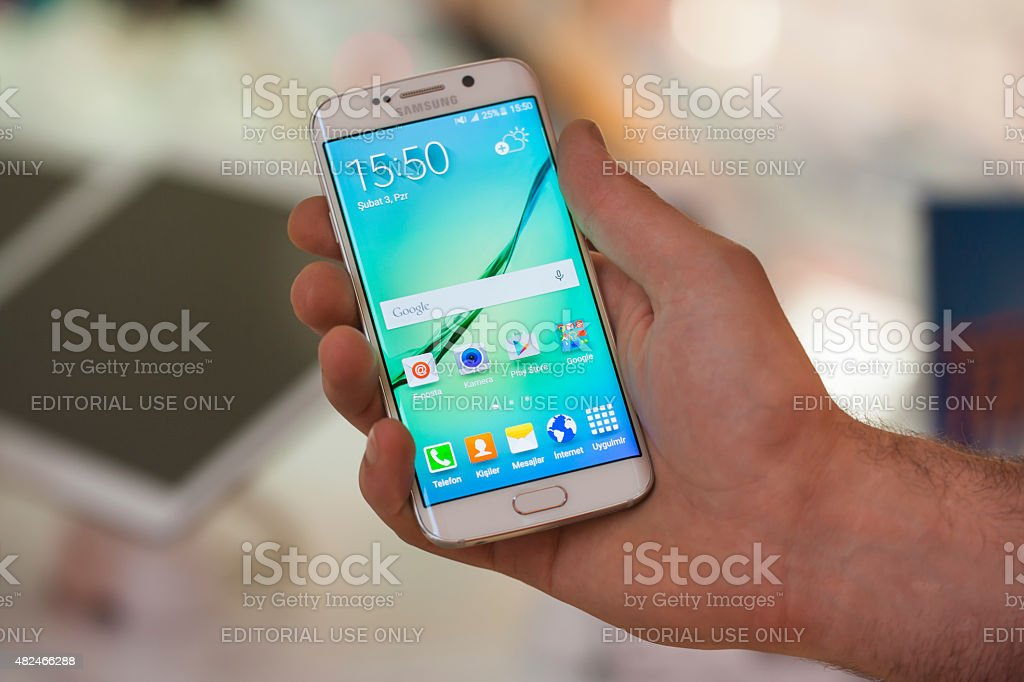 Samsung Galaxy S6 Edge in hand stock photo