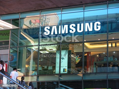 Bangkok, Thailand – April 27, 2014: Exterior view of a Samsung shop in the Siam Square area of Bangkok, Thailand. People can be seen inside the store. Some are outside the store. The picture is taken from the sidewalk.