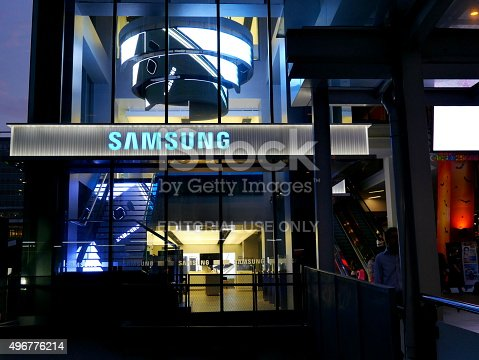 Bangkok, Thailand – November 10, 2015: Exterior view of a Samsung shop in the Siam Square area of Bangkok, Thailand. People walk around the area. The picture is taken from the walkway of sky train station.