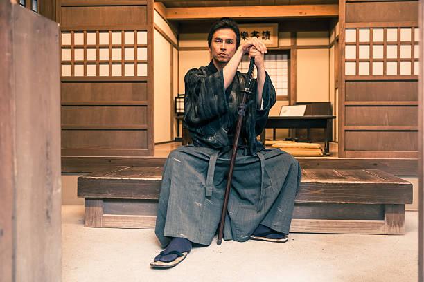 samurai sitting with his katana - kimono ストックフォトと画像