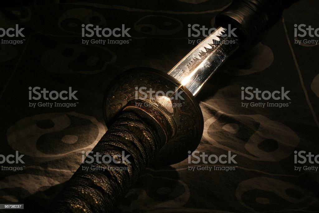 Samurai sword on a yin yang background stock photo