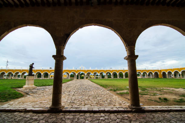 San Antonio de Padua's Convent in Izamal Mexico The 16th-century San Antonio de Padua's Convent is a very impressive building. The yellow color is in honor of the Vatican. There arches all around the building, and a statue of John Paul the II decorate the field. The people of Izamal are still very proud for receiving the pope. st. anthony of padua stock pictures, royalty-free photos & images